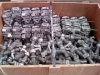 shipping container double ended twist locks and bridge clamps boxed